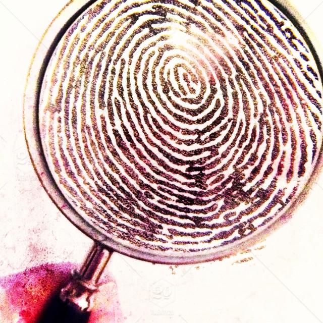stock-photo-metal-glass-handle-swirl-round-lens-unique-investigation-fingerprint-a7e6b323-1c14-4c1d-9fef-3ea16718a02c